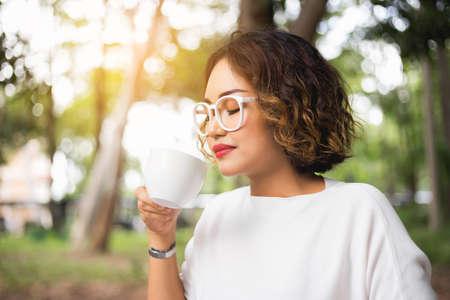 Woman enjoying fresh cooffee stock photo