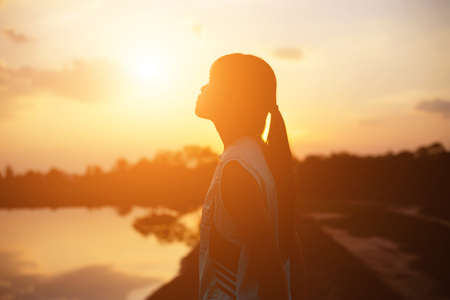 strong confidence woman open arms under the sunset. Reklamní fotografie