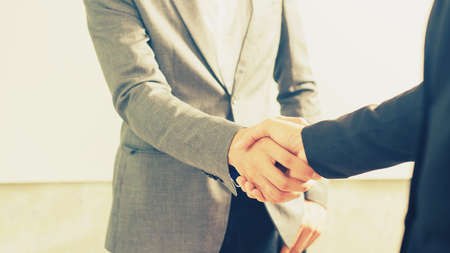 Image of businessmen is shaking hands, businessman agrees to be the same cooperate in order to step through away the bad economy together.  Reklamní fotografie
