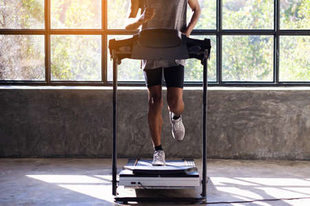 Young men exercise on an automatic treadmill