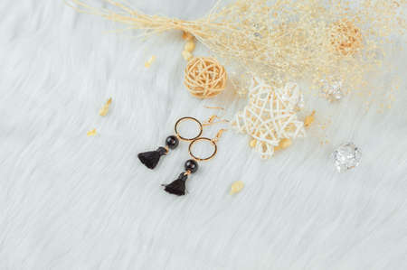 Gold hooped earrings;Black tassels and rattan ornaments.These earrings are handmade by us.Black fringed decoration.Nobility and grace. Stok Fotoğraf
