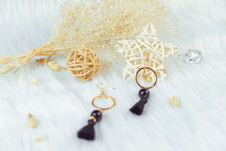 These earrings are handmade by us.Black fringed decoration.Nobility and grace.The earrings are made of metal and the color is like gold.This rattan ornament, shaped like a star or ball, matches perfec