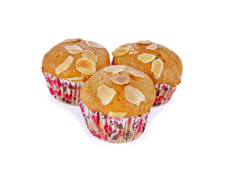 banana muffins topping with almond on a white background