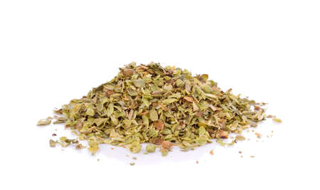 Pile of dried oregano leaves isolated on white background