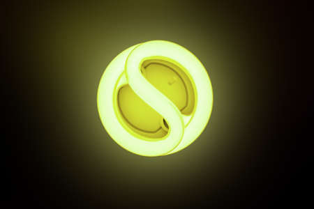 Included energy-saving lamp on a dark background photo