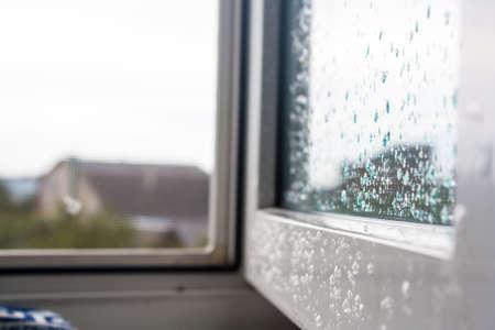 Open window in the drops after rain