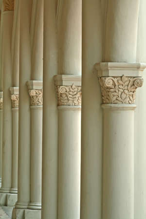 Vertical shot of multiple columns with carvings Stock Photo - 2371403