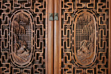 frontal view of door with wood carvings