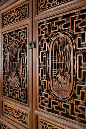 the arts is ancient: side view of door with wood carving decor