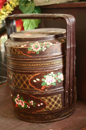 traditional three storey tiffin carrier painted with flower motifs Stock Photo - 2371414