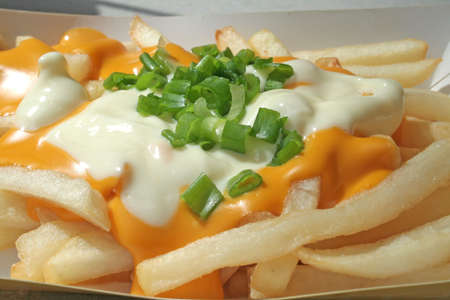 Cheese fries with melted cheese sauce  Stock Photo