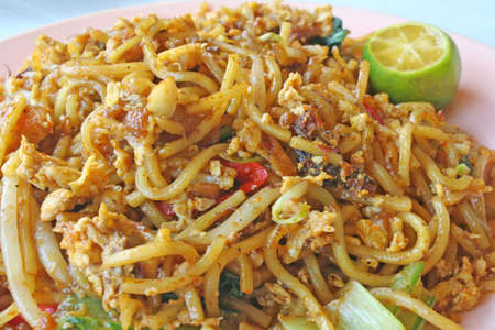 food staple: plate of famous fried egg noodles from malaysia Stock Photo