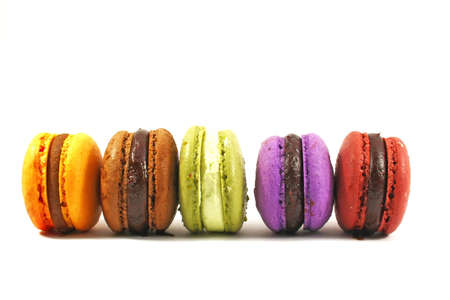 row of five macaroons on white background photo