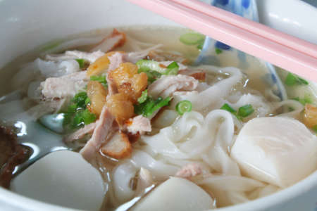 chinese noodles: bowl of chinese rice noodle soup normally consumed for breakfast Stock Photo