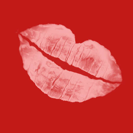 to attract: pink lip imprint against red background