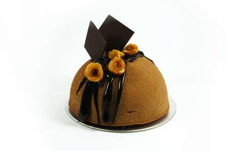dome shaped chocolate mousse cake on isolated white background