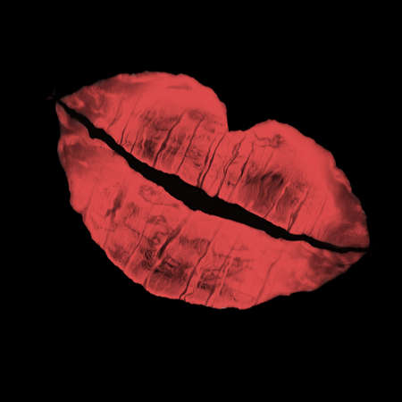 imprint of womans lip on a black color background photo