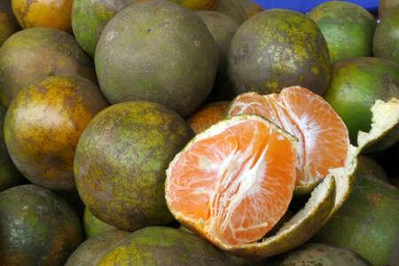juicy mandarin oranges on display at the market photo