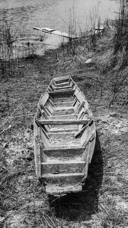 Old rowboat down the reservoir photo