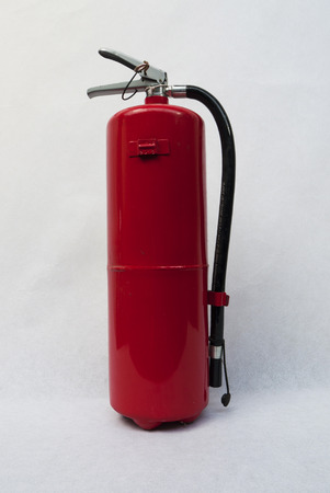 inflammable: fire extinguisher red on white background