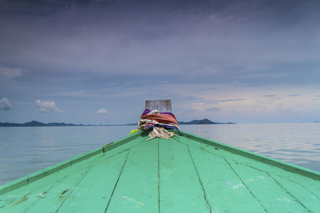 long tailed boat: Head of wooden long tailed boat and sky Stock Photo