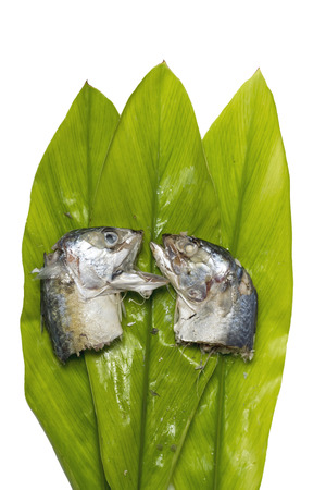 Two mackerel in banana leaf green photo