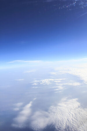 sunny day: view of blue sky and flying Stock Photo