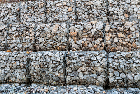 stabilize: Stone walls prevent erosion of the mountain Stock Photo
