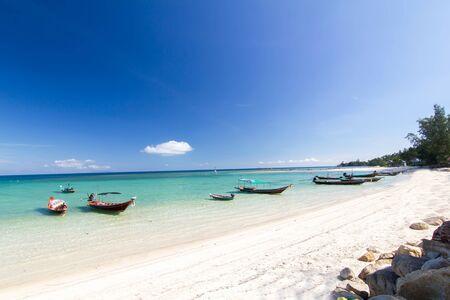 long-tailed boat at the beach and blue sky at Koh Phangan,Surat Thani, thailand thailand