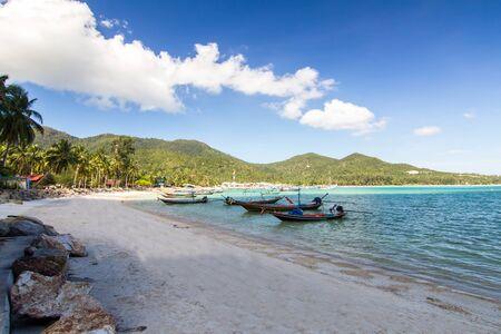 surat: long-tailed boat and  the beach and blue sky at Koh Phangan,Surat Thani, thailand thailand