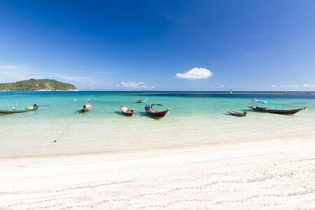 long-tailed boat and  the beach and blue sky at Koh Phangan,Surat Thani, thailand thailand