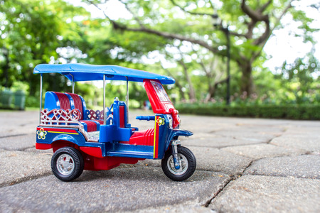 tuk tuk: tuk tuk toy car symbol thailand with blurred bokeh background
