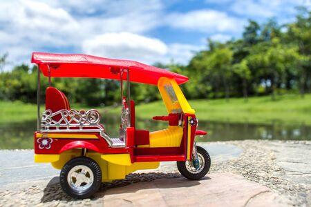tuk: tuk tuk toy car symbol thailand with blurred bokeh background