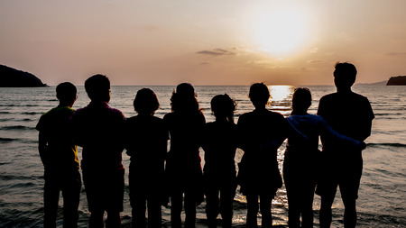 Team Teamwork Relation Together Unity Friendship Concept on beach and sunset