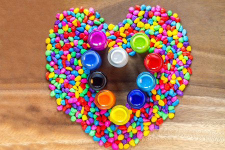 heart shaped stuff: Heart lovely shaped with stones and bottles color abstract on wood background, valentines day Stock Photo