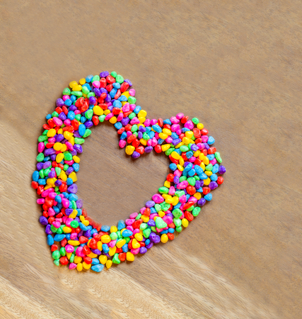 heart shaped stuff: Heart lovely shaped with stones color abstract on wood background, valentines day