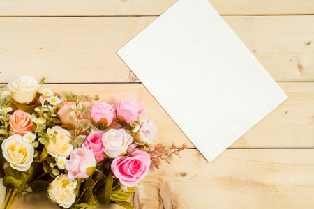 birthday greetings: Roses flowers and empty tag for your text on wooden background