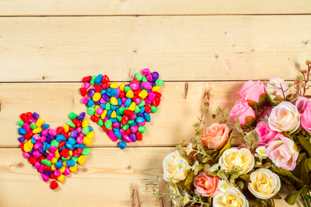 text pink: Roses flowers and empty space on wooden background Stock Photo