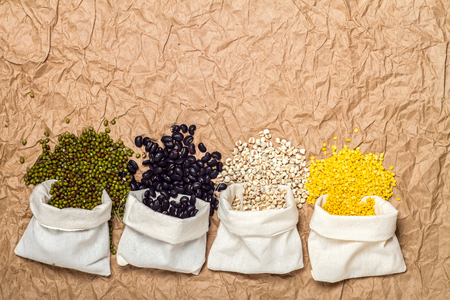 black bean: Type beans and lentils in sack on brown paper background, millet, mung bean, soybean, black bean