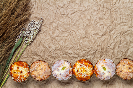 brown paper background: Mix muffins with millet on brown paper background