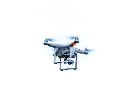 airborne vehicle: Drone hovering in sky Stock Photo