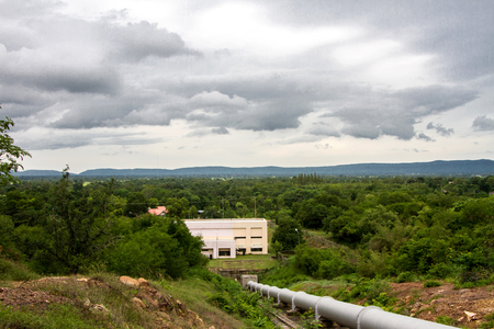 factory power generation: Water pipeline, power generation at a valley in rural area Stock Photo