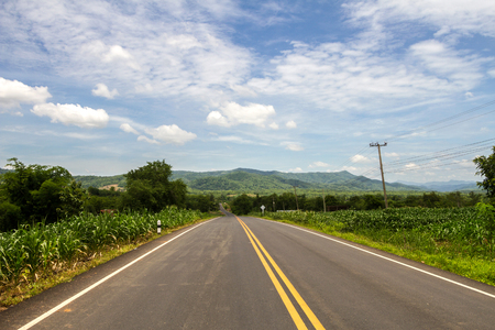 rural area: Mountain road winding in rural area Stock Photo