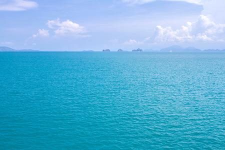 Tropical Beach And Wave Ocean On Sandy Beach Soft. Blue Sky. Background. Stock Photo
