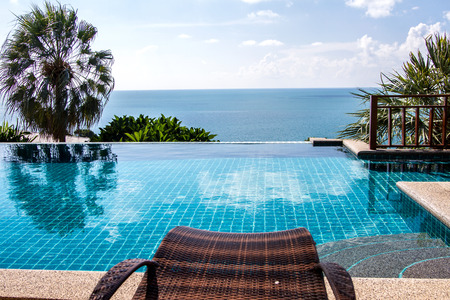pool rooms: Swimming pool looking at blue sea view and blue sky background