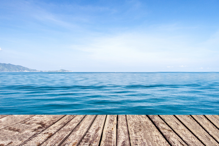 wooden walkway on sea and blue sky background