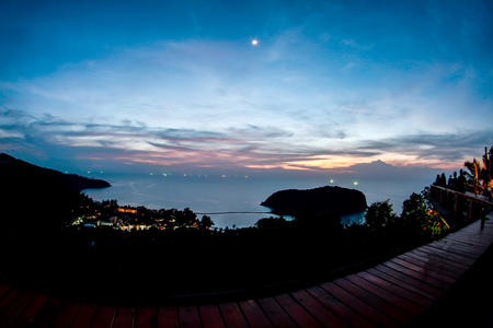 point sunset from top of mountain for see the blue sea waves surface and beach of koh ma, koh phangan, thailand