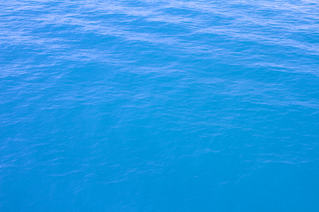 Blue sea waves surface soft and clear sky background Stock Photo