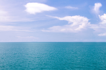 Blue sea waves surface soft and calm with blue sky background Stock Photo