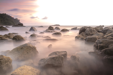 Long exposure image on stone and sunset landscape fo andaman sea, phangnga province,Thailand Imagens